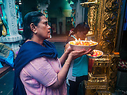 27 DECEMBER 2016 - SINGAPORE: People pray at Sri Veeramakaliamman Temple in Singapore. It is one of the most important Hindu temples in Singapore.      PHOTO BY JACK KURTZ