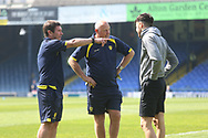 Burton Albion manager Nigel Clough and Assistant manager Andy Garner talk to Burton Albion midfielder Scott Fraser (7) pre-match during the EFL Sky Bet League 1 match between Southend United and Burton Albion at Roots Hall, Southend, England on 22 April 2019.