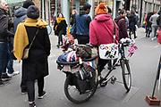 Man with a Google Me bag on Brick Lane, London, UK.