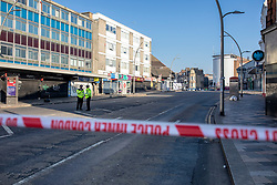 © Licensed to London News Pictures. 27/02/2019. London, UK. The scene outside Ilford Station, where a 20-year-old man was fatally stabbed last night. A murder investigation has been launched. Photo credit: Rob Pinney/LNP