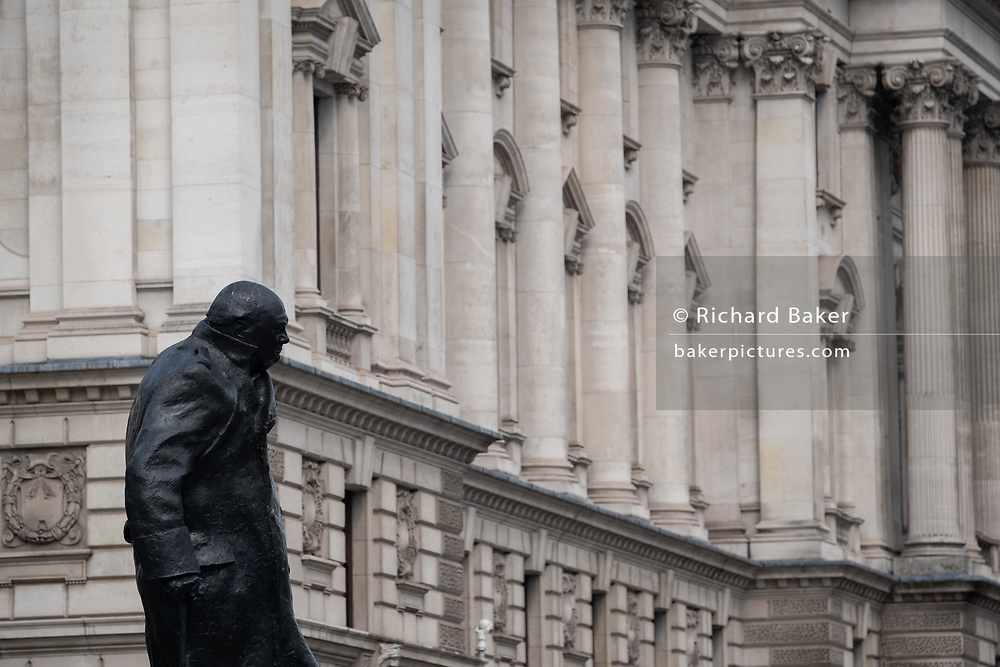 The statue of former British Prime Minister Winston Churchill looks across government buildings in Whitehall, on 16th September 2020, in London, England. Sir Winston Leonard Spencer Churchill was a British statesman, army officer, and writer. He was Prime Minister of the United Kingdom from 1940 to 1945, when he led the country to victory in the Second World War, and again from 1951 to 1955.