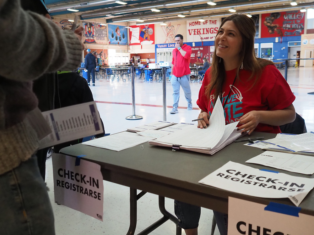 Caucus site co-chair Mercedes Kraus checks in voters at the Valley High School Nevada caucus.