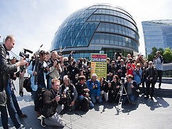 © under license to London News Pictures. 03/05/2011. On World Press Freedom Day around 50 photographers gathered in a Flashmob outside City Hall, London, to protest against the behaviour of private security guards towards photographers. Organised by PhotographerNotATerrorist.org, a letter was delivered to London Mayor Boris Johnson to bring it to the public's attention. Photo credit should read BETTINA STRENSKE/LNP
