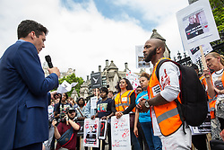 London, UK. 26 June, 2019. Huw Merriman, Conservative MP for Bexhill and Battle, addresses campaigners against knife crime, including families who have lost loved ones to knife crime, at a protest outside Parliament as part of Operation Shutdown to put pressure on the Government, and in particular the next Prime Minister, to take urgent action to prevent knife crime and to protect its citizens.