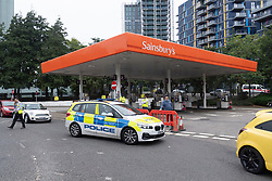 © Licensed to London News Pictures. 25/09/2021. London, UK. A police officers fills up his car with fuel at a closed Sainsburys supermarket petrol station in Alperton, West London due to the current problems with the supply and distribution chain. Companies including BP and Shell have restricted deliveries due to the lack of HGV drivers. Photo credit: Ray Tang/LNP