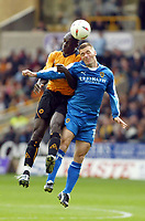 Fotball<br /> Premier League England 2004/2005<br /> Foto: SBI/Digitalsport<br /> NORWAY ONLY<br /> <br /> Wolverhampton Wanderers v Cardiff City<br /> The League Championship. 25/09/2004<br /> Seyi George Olofinjana of Wolves goes up for an aerial ball with Willie Boland of Cardiff