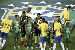 RIO DE JANEIRO, Jan. 26, 2017  Players of Brazil give flowers to players of Colombia before a friendly match at the Engenhao Stadium in Rio de Janeiro, Brazil, Jan. 25, 2017. All the net income of the match will be passed on to the Chapecoense Football Association. (Credit Image: © Li Ming/Xinhua via ZUMA Wire)