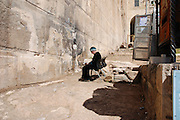 Israel, Palestine, West Bank, Hebron, Jewish Settler praying at the Cave of Machpela