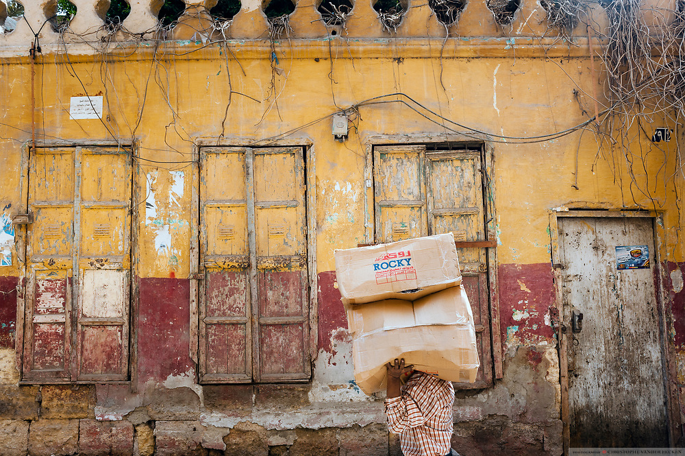 Cairo, Egypt, 2 aug 2012, Man carrying a package on the streets of cairo.