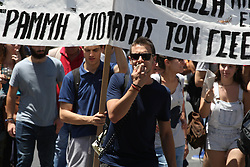 June 14, 2018 - Athens, Greece - Protesters chant slogans during an anti-austerity rally in Athens. Greece and its creditors are working on reaching a final deal next week on the country exiting its international bailout this summer, the European Commission's vice president said Thursday, adding that the bailout exit was ''delicate yet perfectly doable' (Credit Image: © Aristidis Vafeiadakis via ZUMA Wire)