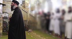 File- The leader of the militant Islamic State (ISIS), Abu Bakr al-Baghdadi has made what would be his first public appearance at a mosque in the centre of Iraq's second city Mosul, according to a video recording posted on the Internet on July 5, 2014, in this still image taken from video. There had previously been reports on social media that Abu Bakr al-Baghdadi would make his first public appearance since his Islamic State in Iraq and the Levant (ISIS) changed its name to the Islamic State and declared him caliph. The Iraqi government denied that the video, which carried Friday's date, was credible. It was also not possible to immediately confirm the authenticity of the recording or the date when it was made. Mosul. Iraq. 05/07/2014 ©SALAMPIX/ABACAPRESS.COM