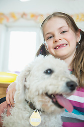 Portrait of girl with her dog, smiling