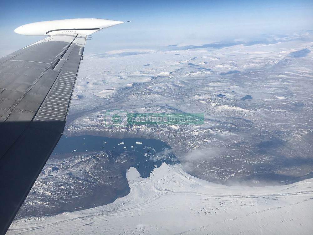 August 30, 2017 - Greenland - NASA's Operation IceBridge is flying its summer Arctic land ice campaign in Greenland, continuing its measurements of the Greenland Ice Sheet and its outlet glaciers. For the next four weeks, IceBridge will be flying the Land, Vegetation, and Ice Sensor (LVIS) on board Dynamic Aviation's B-200T King Air aircraft, first out of Thule Air Base, and then Kangerlussuaq, Greenland. This photograph from the mission was taken on Aug. 29, 2017, from 28,000 feet, looking north while surveying Nioghalvfjerdsbrae (79 N) Glacier in northeast Greenland. (Credit Image: © Bryan Blair/NASA via ZUMA Wire/ZUMAPRESS.com)