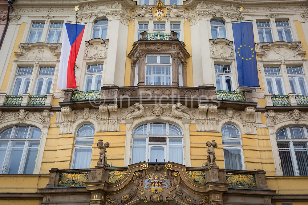 The Czech and EU flags hang outside a building on Old Town Square Staromestske namesti,  on 18th March, 2018, in Prague, the Czech Republic.