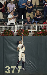September 13, 2017 - Minneapolis, MN, USA - Minnesota Twins outfielder Eddie Rosario could not reach a ball hit by the San Diego Padres' Austin Hedges for a solo home run in the eighth inning on Wednesday, Sept. 13, 2017, at Target Field in Minneapolis. The Twins won, 3-1, in 10 innings. (Credit Image: © Carlos Gonzalez/TNS via ZUMA Wire)