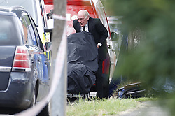 © Licensed to London News Pictures. 19/06/2020. London, UK. A body is removed from the scene in North Cheam after a fatal shooting. Police were called at 01:12hrs on Friday, 19 June to reports of shots fired on Brocks Drive in North Cheam. Officers, including firearms officers, attended, and found a man, believed to be in his mid-20s, in the street suffering from a gunshot injury. They immediately provided first aid. The London Ambulance Service and London's Air Ambulance also attended but despite the efforts of officers and paramedics, the man was pronounced dead at the scene at 01:45hrs. Photo credit: Peter Macdiarmid/LNP