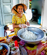 Chef Nghi works to untangle her rice noodles for Mi Quang, her speciality.