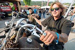 High School riding out from the Iron Horse Saloon during the annual Sturgis Black Hills Motorcycle Rally. Sturgis, SD. USA. Saturday August 5, 2017. Photography ©2017 Michael Lichter.
