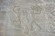 Petroglyph, rock carving, of two warriors fighting, the one on the right has a headress and they both have shields. Carved by the ancient Camunni people in the iron age between 1000-1200 BC. Rock no 6, Foppi di Nadro, Riserva Naturale Incisioni Rupestri di Ceto, Cimbergo e Paspardo, Capo di Ponti, Valcamonica (Val Camonica), Lombardy plain, Italy .<br /> <br /> Visit our PREHISTORY PHOTO COLLECTIONS for more   photos  to download or buy as prints https://funkystock.photoshelter.com/gallery-collection/Prehistoric-Neolithic-Sites-Art-Artefacts-Pictures-Photos/C0000tfxw63zrUT4<br /> If you prefer to buy from our ALAMY PHOTO LIBRARY  Collection visit : https://www.alamy.com/portfolio/paul-williams-funkystock/valcamonica-rock-art.html