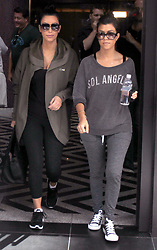 Kim and Kourtney Kardashian going to the gym in Tribeca, New York, NY on August 31, 2011.The reality TV star sisters begining to film the season two of 'Kourtney and Kim Take New York'.<br /> Photo by Charles Guerin/ABACAPRESS.COM  | 287802_004