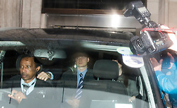"""© London News Pictures. 25/04/2012. London, UK. Adam Smith (centre), former aide to Jeremy Hunt  being driven from the Department for Culture Media and Sport in London on April 25, 2012.  Adam Smith  quit   admitting his contact with News Corporation over the BSkyB takeover """"went too far"""". Photo credit : Ben Cawthra /LNP"""