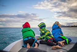 Children admiring seascape from boat, Mauritius