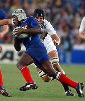 Photo. Steve Holland. England v France, Semi-final at the Telstra Stadium, Sydney. RWC 2003.<br />16/11/2003.<br />Serge Betsen is tackled by Ben Kay, right.