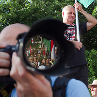 Photographer taking pictures of a political gathering organized by far-right party Jobbik in a public place in central Budapest, Hungary. Sunday, 04. July 2010. ATTILA VOLGYI