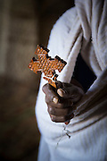 Detail of a priest holding a cross, the Mariam Korkor Church. Tigray, Ethiopia, Horn of Africa