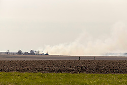 Smoke billows across the plains from a farmer burning debris that accumulated over the winter