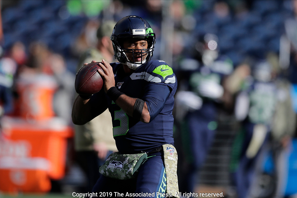 Seattle Seahawks quarterback Russell Wilson passes during warmups before an NFL football game against the Tampa Bay Buccaneers, Sunday, Nov. 3, 2019, in Seattle. (AP Photo/John Froschauer)