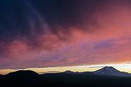Alpenglow on clouds at sunset above Lassen Peak, Lassen Volcanic National Park, California