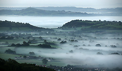 © Licensed to London News Pictures. 26/09/2015. Glastonbury, UK .A mist covered landscape looking towards Glastonbury Tor in Somerset on an early autumn morning.. Photo credit : Jason Bryant/LNP