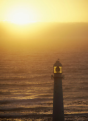 Waves coming ashore in front of the lighthouse at Kommitjie at dusk, Cape peninsula, South Africa. (Credit Image: © Axiom/ZUMApress.com)