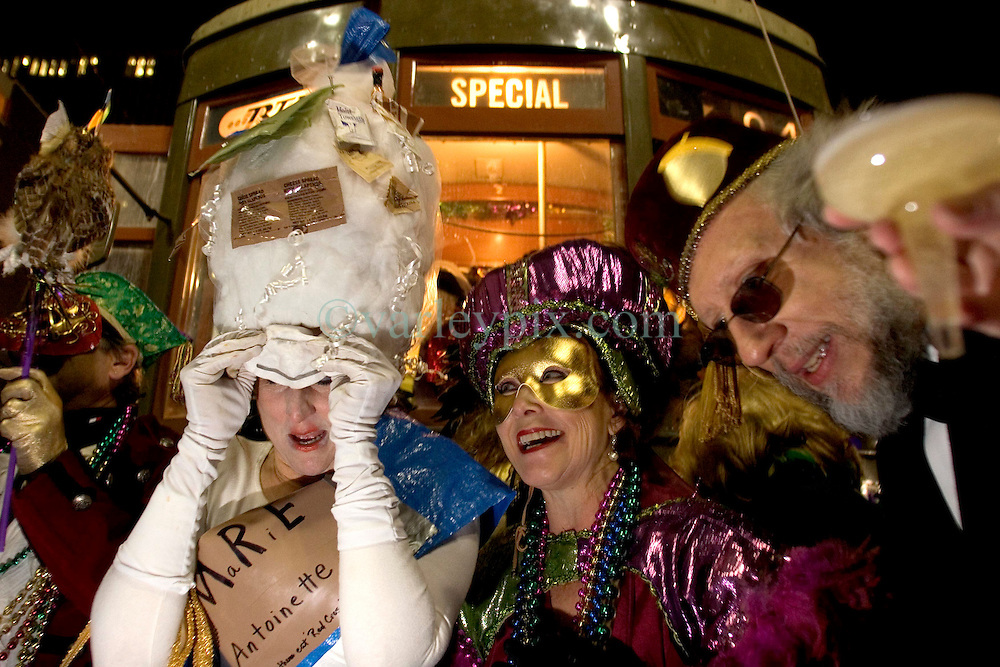 06 Jan, 2006. New Orleans, Louisiana.  Post Katrina aftermath.<br /> 12th Night, New Orleans, Louisiana. Mardi Gras begins. The Mardi Gras krewe of Phunny Phorty Phellows gather on Canal Street to take a street car through the city. Their traditional route along St Charles Ave had to be cancelled because street cars are still unable to travel the route. Let the champagne flow. Queen of Mardi Gras, 'MRE Antoinette' readies the krewe to board the street car.<br /> Photo; Charlie Varley/varleypix.com