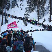 The third and last day of the Strike WEF march on Davos, 19th of January 2020, Switzerland. The march is coming off the path to cross the main road to Davos. Some of the activists wanted to take the road for political reasons but police blocked them from doing so. No arrests were made. The authorities had refused permission for the march to walk on the road into Davos so many hiked across the mountains from Klosters to get there. The march is a three day protest against the World Economic Forum meeting in Davos. The activists want climate justice and think that The WEF is for the world's richest and political elite only.