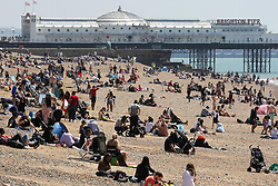 © Licensed to London News Pictures. 30/05/2021. Brighton, UK. Sun-seekers flock to the Brighton seafront on the hottest day of the year so far. According to the Met Office, a high of 24 degrees celsius is forecast for the bank holiday weekend, after weeks of rain in the South East of England. Photo credit: Dinendra Haria/LNP