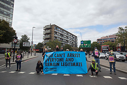 © Licensed to London News Pictures. 30/08/2020. London, UK. Climate protesters block the Elephant & Castle roundabout in central London. Extinction Rebellion activists announce disruptions in London and other cities starting on Tuesday. Photo credit: Marcin Nowak/LNP