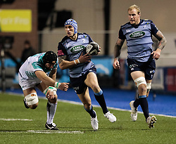 Cardiff Blues' Tom James evades the tackle of Connacht's John Muldoon<br /> <br /> Photographer Simon King/Replay Images<br /> <br /> Guinness Pro14 Round 9 - Cardiff Blues v Connacht Rugby - Friday 24th November 2017 - Cardiff Arms Park - Cardiff<br /> <br /> World Copyright © 2017 Replay Images. All rights reserved. info@replayimages.co.uk - www.replayimages.co.uk