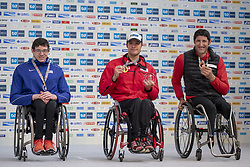 March 3, 2019 - Tokyo, Tokyo, Japan - Second-placed Romanchuk Daniel (L) of USA and third-placed Van Dyk Ernst Franco (R) of RSA wave with first-placed Hug Marcel (C) of SUI as they pose for photographers during the awards ceremony for the wheelchair Tokyo Marathon in Tokyo on March 3, 2019. (Credit Image: © Alessandro Di Ciommo/NurPhoto via ZUMA Press)
