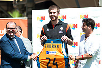 Valencia Basket Club's new player John Shurna (c) with the President Vicente Jose Sola Sanz (l) during his official presentation. August 27, 2015. (ALTERPHOTOS/Javier Comos)