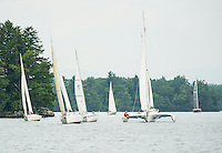 Sailors round Welch Island during the Winnipesaukee Yacht Club's JBT Memorial Sailboat race on Saturday.  (Karen Bobotas/for the Laconia Daily Sun)