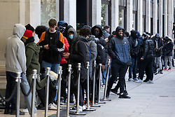 © Licensed to London News Pictures. 12/04/2021. London, UK. Shoppers queue outside Selfridges department store on Oxford Street. From today gyms, non essential retail and theme parks can reopen following the easing of lockdown restrictions. Photo credit: George Cracknell Wright/LNP