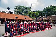 Graduating students celebrating at the Temple Of Literature in Hanoi, Vietnam.