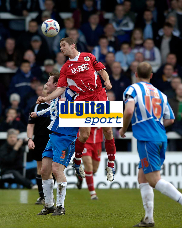 Photo: Jed Wee.<br />Hartlepool United v Bristol City. Coca Cola League 1. 15/04/2006.<br /><br />Bristol City's Alex Russell (R) jumps highest to win the ball from Hartlepool's Hugh Robertson.