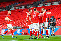 LONDON, ENGLAND - MARCH 31: Jakub Moder, Jan Bednarek and Maciej Rybus of Poland celebrates scoring the goal with during the FIFA World Cup 2022 Qatar qualifying match between England and Poland on March 31, 2021 in London, United Kingdom. Sporting stadiums around the UK remain under strict restrictions due to the Coronavirus Pandemic as Government social distancing laws prohibit fans inside venues resulting in games being played behind closed doors. (Photo by Wlosek/PressFocus/MB Media)