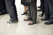 feet and legs of business commuters waiting for the train to arrive Tokyo Japan