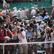 2017 French Open Tennis Tournament - Day Fifteen. One photographer shooting with an iPhone as tennis photographers shoot the trophy presentation after Rafael Nadal of Spain defeated Stan Wawrinka of Switzerland in the Men's Singles Final match on Philippe-Chatrier Court at the 2017 French Open Tennis Tournament at Roland Garros on June 11th, 2017 in Paris, France.  (Photo by Tim Clayton/Corbis via Getty Images)