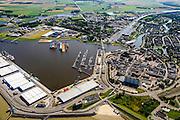 Nederland, Groningen, Delfzijl, 05-08-2014; haven Delfzijl met droogdokken en jachthaven Neptunus. Gezien naar Zeehavenkanaal, links de  Eems, stadscentrum in de voorgrond en Eemskanaal midden rechts.<br /> Delfzijl harbor with docks and marina Neptune. <br /> luchtfoto (toeslag op standard tarieven);<br /> aerial photo (additional fee required);<br /> copyright foto/photo Siebe Swart