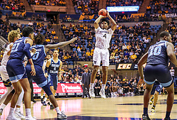 Dec 1, 2019; Morgantown, WV, USA; West Virginia Mountaineers guard Miles McBride (4) shoots a jumper during the second half against the Rhode Island Rams at WVU Coliseum. Mandatory Credit: Ben Queen-USA TODAY Sports